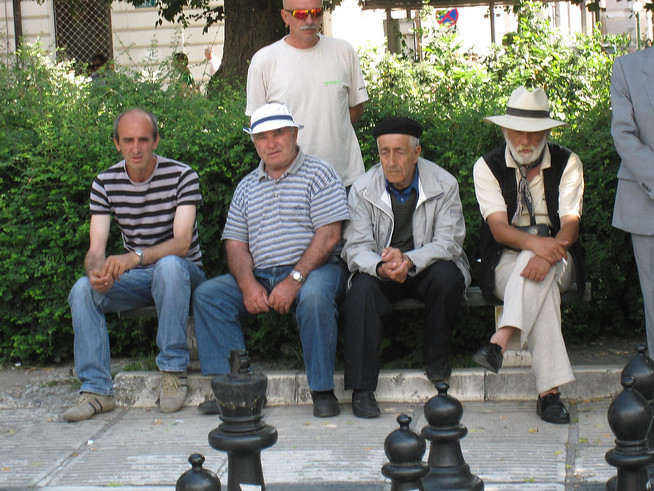 Old Men Watching a chess game