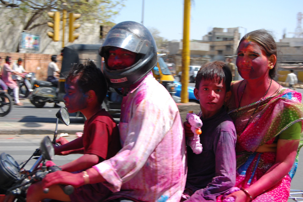 A colorful family during Holi in India