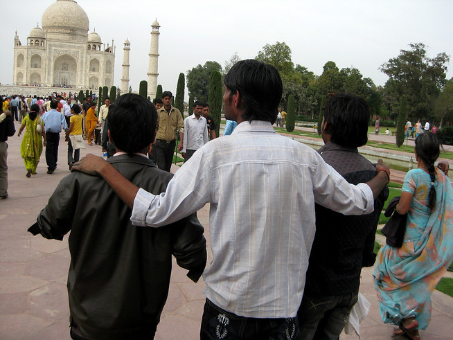 Friends visit the Taj Mahal, India.