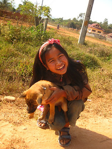 Laotian kid with a puppy