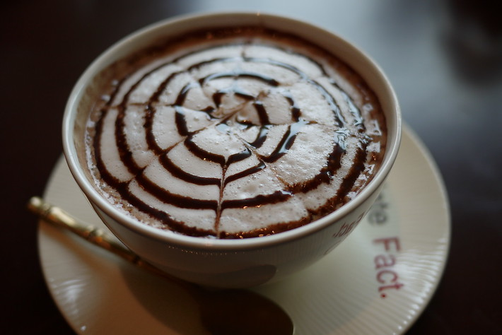 Latte art on my dark chocolate latte from a chocolate shop in Chiang Mai.