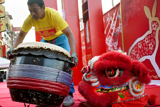 Constructing the stage at the Chinese New Year festivities in Chiang Mai, Thailand.